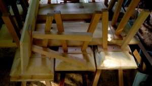 Pine benches with tapered oak legs.