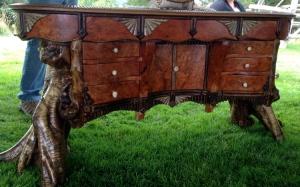 Shop-sawn cherry burl veneer on this bombe-influenced desk.